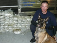 Officer Chris Porter with his K9 and their 380 lbs. of marijuana